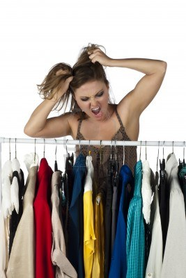 17352952-frustrated-woman-finding-it-difficult-to-choose-clothes-from-a-clothes-rack